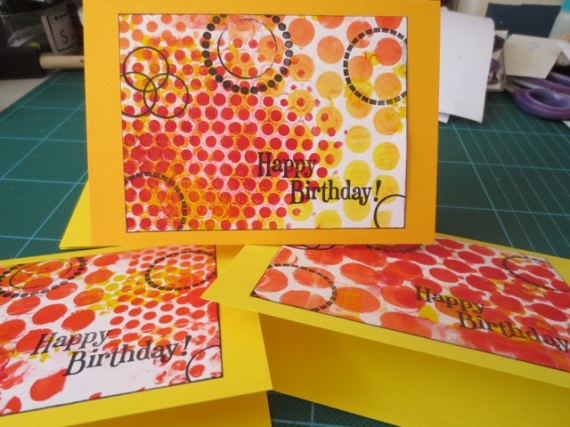 using red tones gelli plate prints for handmade greeting cards
